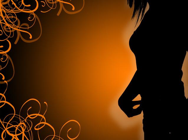 Erotická silueta žena, oranžové pozadie.jpg
